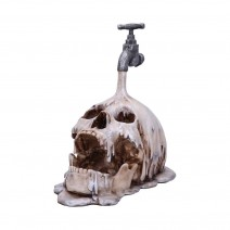 Tapped Pouring Tap Skull Figurine